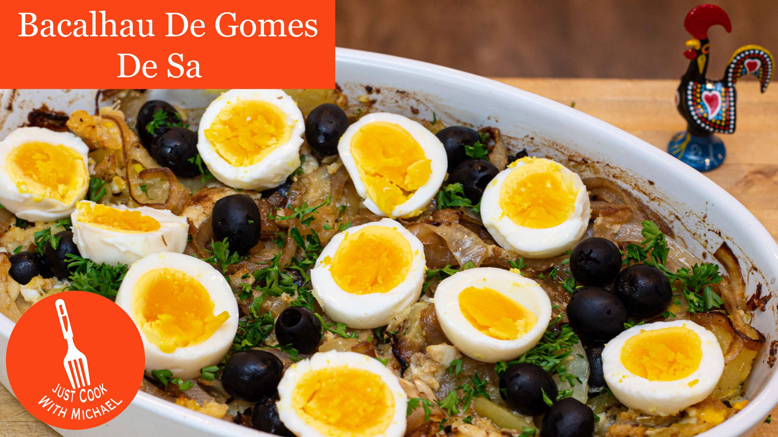Portuguese Bacalhau a Gomes de Sa, Salt Cod Casserole, with hard boiled eggs and black olives on top, in white casserole dish