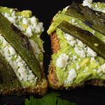 Avocado Toast topped with queso fresco and charred poblano peppers