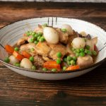 Chicken Coq Au Vin with carrots peas and pearl onions in bowl
