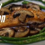 Crispy salmon plated with browned mushrooms and asparagus