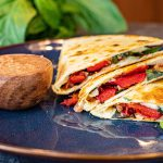 Italian Fusion Quesadilla in three wedged slices on a plate