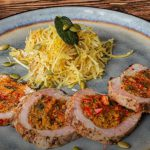Stuffed pork tenderloin sliced with side of roasted spaghetti squash