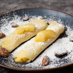 Apple filled Crepes sprinkled with powdered sugar