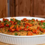 Portuguese Bacalhau de Natas, salt cod casserole with cream, topped with parsley and cherry tomatoes