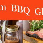 Plum BBQ Glaze beside a smoked bbq Brisket