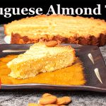 Portuguese Almond Tart, Bolo de Amêndoa, slice on plate in front and remaining tart in the background
